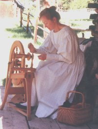 Nancy doing a historical spinning demonstration